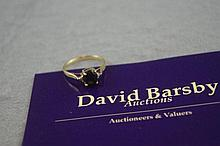 9ct yellow gold and sapphire ring with 2 simulated