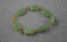Natural green stone and gilt bracelet