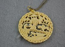 Carved ivory pendant
