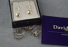 Three various pairs of silver earrings