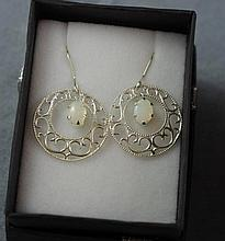 Sterling silver and opal earrings in an antique