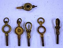Six antique watch keys