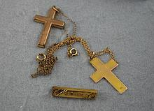 9ct gold cross and an antique silver gilt cross on