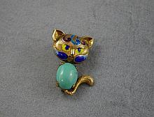 Silver gilt, enamel and turquoise cat brooch