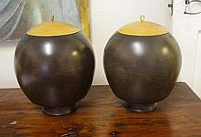 Pair of wooden urns with lids