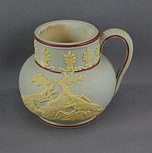 Antique English Jasperware jug decorated with