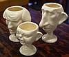 Three novelty Royalty egg cups 10.5cm high