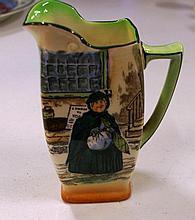 Royal Doulton Dickens ware jug 12 cms tall.