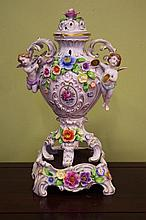 German porcelain floral encrusted urn with