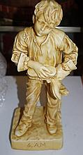 Victorian ivory coloured pottery figure of a boy