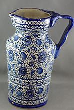 Early tin glaze jug approx 25cm high