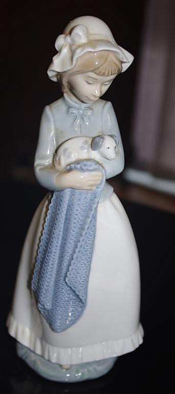 Nao figure of a girl with dog