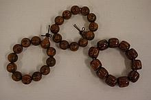 Three oriental timber bead bracelets