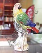Meissen figurine of parrot on branch height 15cm