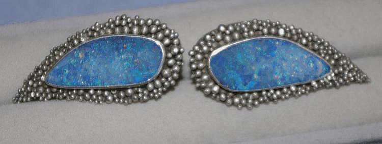 Pair of artisan clip-on opal and silver earrings