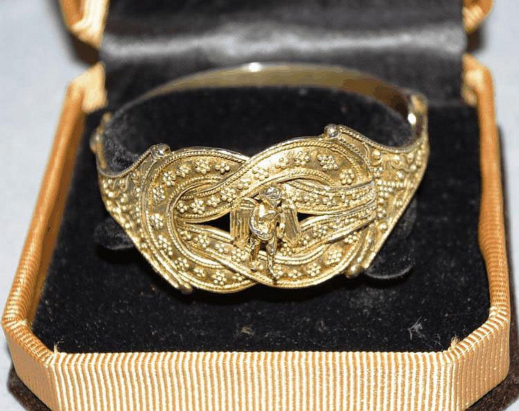 Silver gilt bracelet with winged cupid bought in