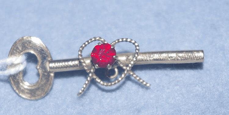 9ct gold gem set key brooch