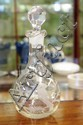 Antique condiment bottle with etched kookaburra on