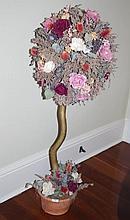 Faux standard flowers in pot