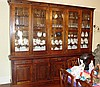 Large stained pine dresser with 5 glazed cupboards