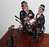 Charlie Chaplin figure on bike