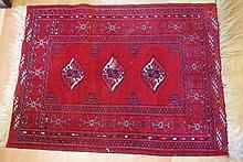 Vintage oriental wool rug with dark red tones and