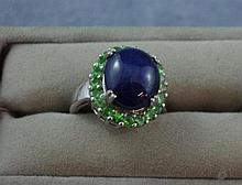 Silver, star sapphire and green garnet ring