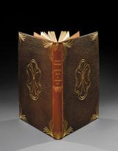 MAURRAS (Charles). LOUIS XIV OU L' HOMME - ROI. Orné de bois dessinés et gravés par Jean VitalProst. PARIS, EDITIONS DU CADRAN, s. d. Un volume, in-4, de (49) ff., (2) ff., 58 pp., (1) f., pleinereliure en maroquin marron. Dos lisse décoré et portant