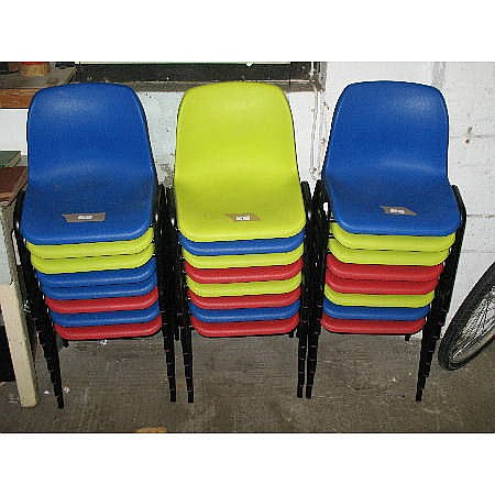 Twenty four infant plastic stacking chairs in