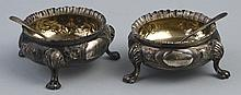 A pair of Victorian salts, of circular form with gadrooned rim, the body em
