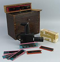 A late Victorian child's tinplate projector, with conical spirit burner, 20