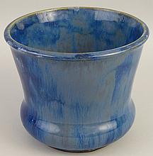 A Royal Doulton stoneware jardiniere, of tapering circular form with bulbou
