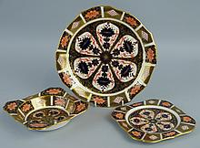 A Royal Crown Derby plate, in the Imari pattern, number 1128, of shaped cir