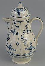 A German coffee pot, of pear shaped form with domed cover painted in blue a