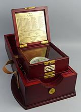 A modern marine chronometer, the silvered dial with Roman numerals inscribe