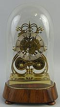 A brass skeleton clock, with double fusee eight day movement striking on a