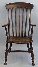 An elm and fruitwood Windsor armchair, the high back with curved crest rail