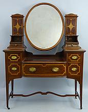 An Edwardian mahogany dressing table, by Shapland & Petter of Barnstaple wi
