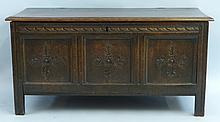 A 19th Century oak coffer, with moulded edged hinged lid over three panelle