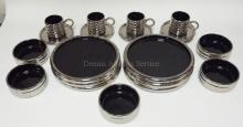 20 PC BLACK AND SILVER DINNERWARE MADE IN ITALY FOR GEORG JENSEN. PLATES ARE 10 1/2 IN