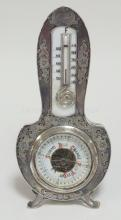 STERLING SILVER CASED DESK BAROMETER/ THERMOMETER. 7 1/4 IN H. LEBKUECHER & CO (1896-1909)