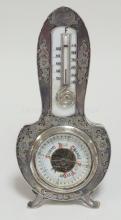 STERLING SILVER CASED DESK BAROMETER/ THERMOMETER. 7 1/4 IN H. LEBKUECHER & CO (1896-1909)