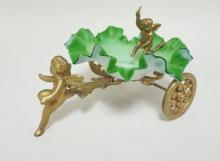 GREEN AND WHITE CASED SATIN GLASS RUFFLED BOWL IN A GILT METAL *CART* W/ CHERUBS. BOWL IS 6 IN