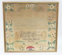 FRAMED 1834 SAMPLER BY CATHERINE TAYLOR, AGED 11 YRS. HAS EMBROIDERED FLOWERS AROUND THE BORDER. 16 1/2 IN X 15 1/2 IN