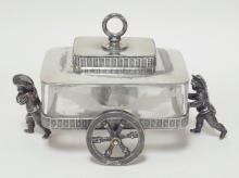 MERIDEN SILVER PLATE AND ENGRAVED GLASS FIGURAL SARDINE CART. HAS BOYS PUSHING AND PULLING. FISH ANMD SEAWEED ENGRAVED ON THE GLASS. 7 3/4 IN LONG, 5 1/4 IN H