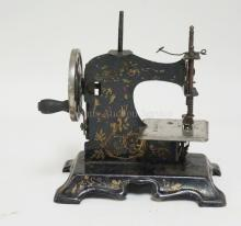 MINIATURE SEWING MACHINE W/ ORIG. LITHO. 6 1/2 IN H NO. 325936