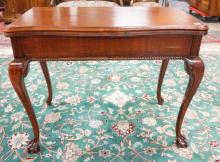 MAHOGANY FLIP TOP EXTENSION TABLE WITH CARVED BALL & CLAW FEET. 39 IN WIDE. 31 IN TALL. 20 1/2 IN DEEP.