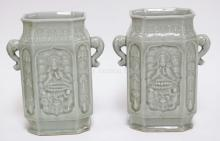 PAIR OF CHINESE CERAMIC VASES IN GREEN. 10 IN TALL. DRILLED FOR LAMPS.