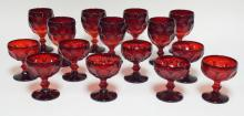 15 PC RUBY STEMWARE IN A HONEYCOMB/ THUMBPRINT PATTERN. SEVEN 5 3/4 IN GOBLETS AND EIGHT 4 IN SHERBERTS