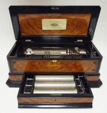 MERMOD FRERES CYLINDER MUSIC BOX IN INLAID CASE W/ EBONIZED TRIM. HAS CELLULOID LABEL INSIDE THE LID *IDEAL GUITARE*, *ANY NUMBER OF CYLINDERS CAN BE OBTAINED FOR THIS BOX*.HAS A SHIELD SHAPED COMBINED CHANGE/REPEAT AND TUNE SELECTOR.  HAS A DRAWER